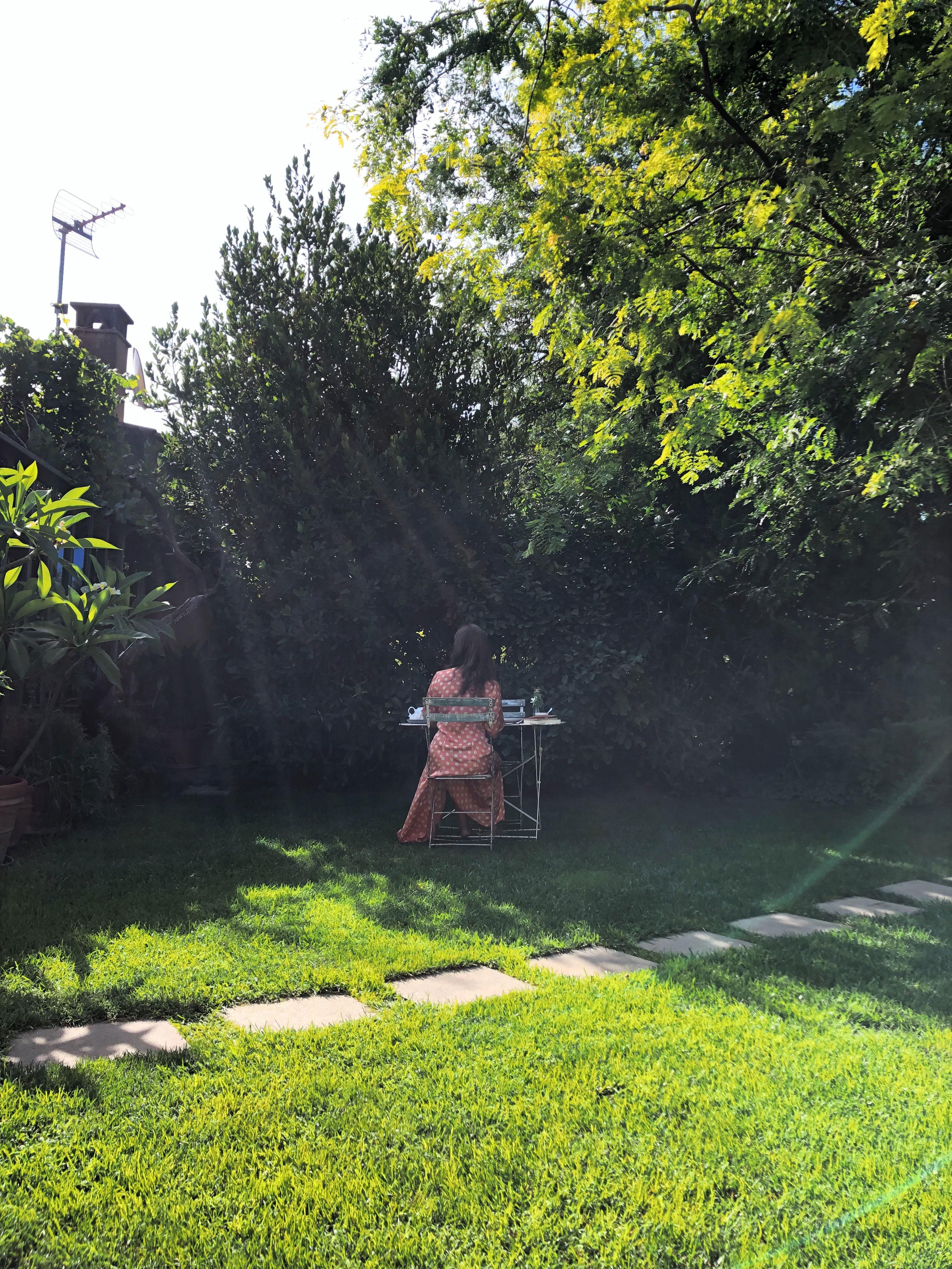 Girl having breakfast in the garden